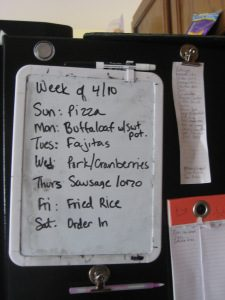 "Our weekly menu whiteboard. Top right is our ""go to"" meals list, and below that is our grocery shopping list"
